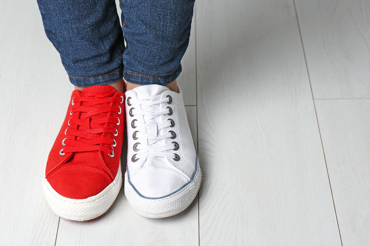 Two identical shoes - 1 red, 1 white