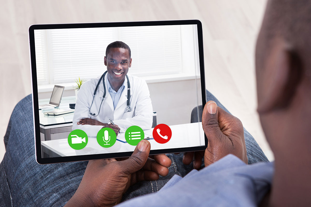 African-American young adult having a telemedicine appointment with African-American doctor